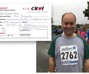Pat at the 'Streets of Galway' with receipt from Croí.